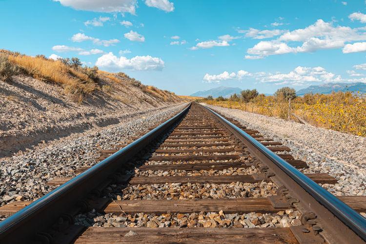 View of railroad tracks against sky in utah