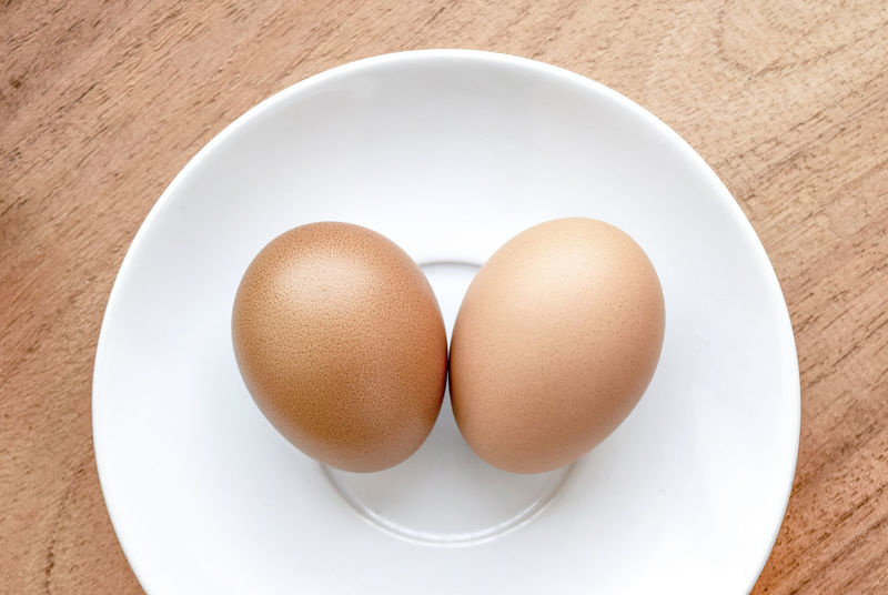 Boiled Boiled Egg Bowl Breakfast Brown Close-up Directly Above Egg Egg Yolk Eggcup Eggshell Food Food And Drink Freshness Healthy Eating High Angle View Indoors  No People Plate Protein Raw Food Serving Size Still Life Studio Shot Table