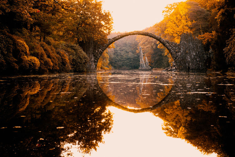 Architecture Atmosphere Bridge Bridge - Man Made Structure Built Structure Connection Glowing Horizontal Symmetry Long Exposure Lordoftherings Outdoors Reflection Ring River Sunbeam Tree Water