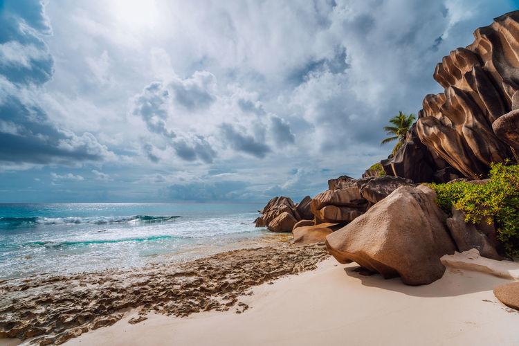View of rocks on beach against sky