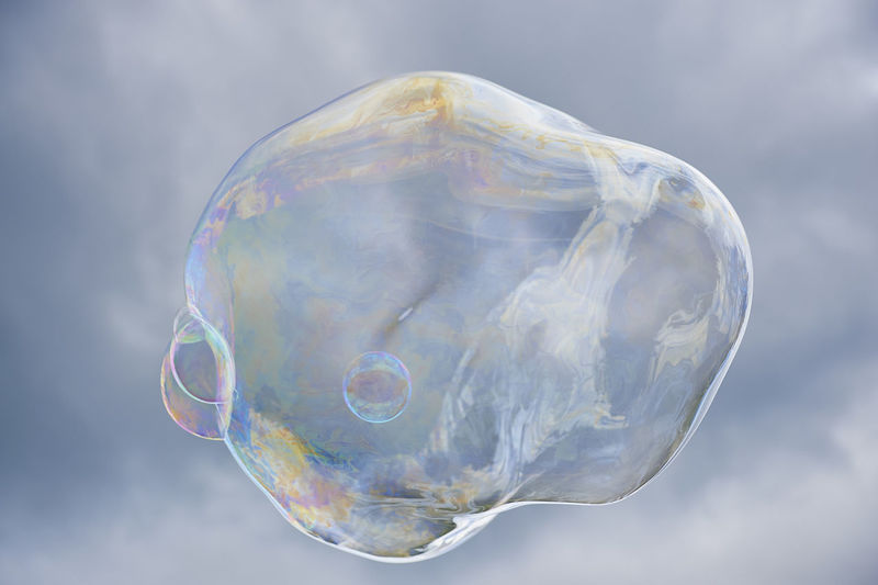 Low Angle View Of Bubble Against Cloudy Sky