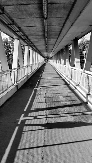 Way Shadow Bridge - Man Made Structure Sunlight Footbridge Diminishing Perspective Architecture Built Structure Passageway Colonnade Long Architectural Column Pathway