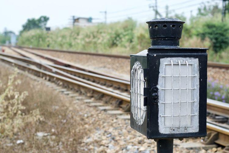 Close-up of signal at railroad track