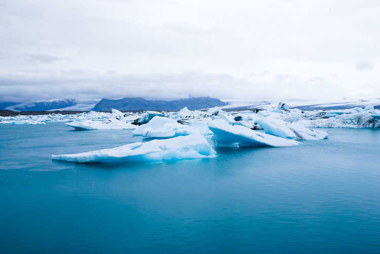Ice cold lagoon Water Glacier Ice Sea Tranquil Scene Cold Temperature Scenics - Nature Winter Beauty In Nature Sky Iceberg - Ice Formation Cloud - Sky Environment Landscape Floating Frozen Floating On Water No People Iceberg Lagoon Melting Nikon Nikonphotography Iceland Iceland_collection