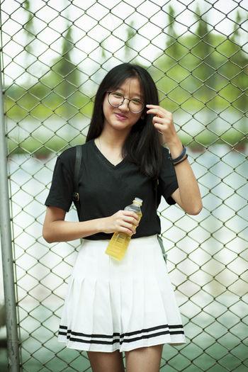 Portrait of girl standing outdoors