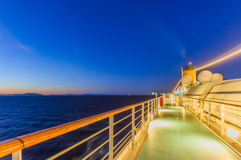 Scenic view of sea against blue sky at night from cruise ship deck