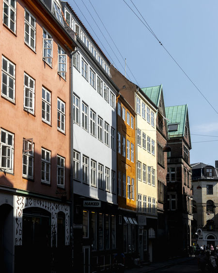 Copenhagen, Denmark Apartment Architecture Building Building Exterior Built Structure Car City Clear Sky Copenhagen Day Low Angle View Mode Of Transportation Motor Vehicle Nature No People Outdoors Residential District Row House Sky Street Sunlight Transportation Window