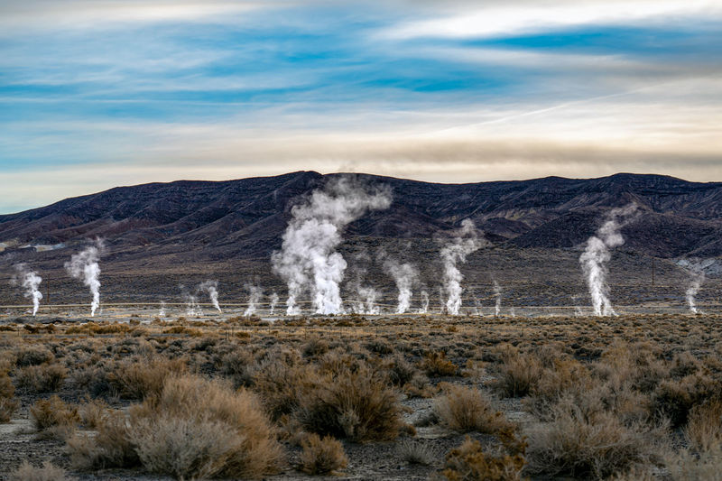 Steam rising from geothermal vents in the nevada desert at nightengale near reno.