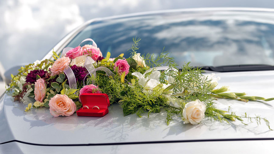Flower decoration and a ring set on gray wedding car bonnet. Beauty In Nature Bouquet Centerpiece Close-up Day Flower Flower Head Fragility Freshness Nature No People Outdoors Rose - Flower Wedding