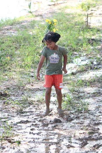 Full length of girl standing on land