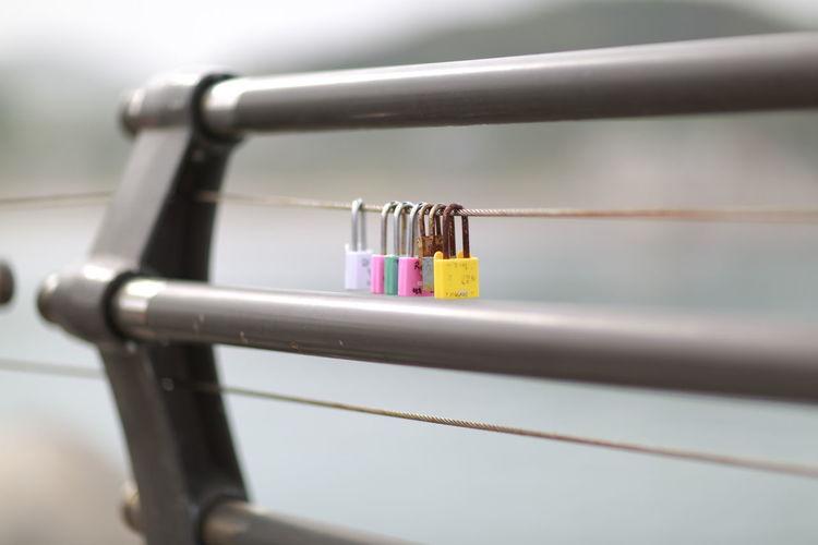 Close-up Of Pad Locks On Railing
