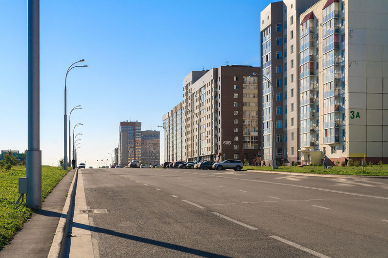 Kuzbass Avenue in Kemerovo city. Architecture Building Building Exterior Built Structure City Cityscape Clear Sky Day Residential District Road Siberia Sky Street Street Light The Way Forward Transportation