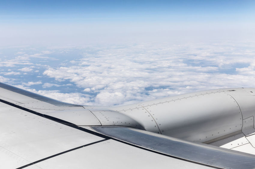 Part of aircraft wing above the clouds Cloudscape Copy Space Part Of Sunny Textured  Aerial View Aircraft Wing Airplane Beauty In Nature Blue Close-up Cloud - Sky Cumulus Cloud Day Directly Above Distant Eternity Flying High Angle View Horizon Over Land Mid-air Mode Of Transport No People Sky White Color