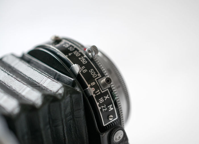Cropped image of camera over white background