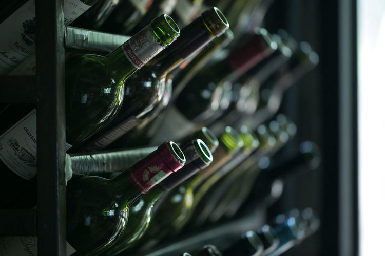 High angle view of wine bottles in rack