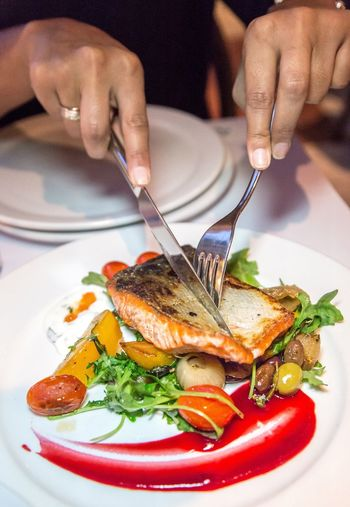 Cutting into a Wild Sockeye Salmon Food And Drink Plate Food Fork Healthy Eating Human Hand Meal Real People Table Serving Size Freshness Seafood Indoors  One Person Eating Ready-to-eat Close-up Human Body Part Lifestyles Day Cut Oceanwise Sockeye Salmon Entree Dinner