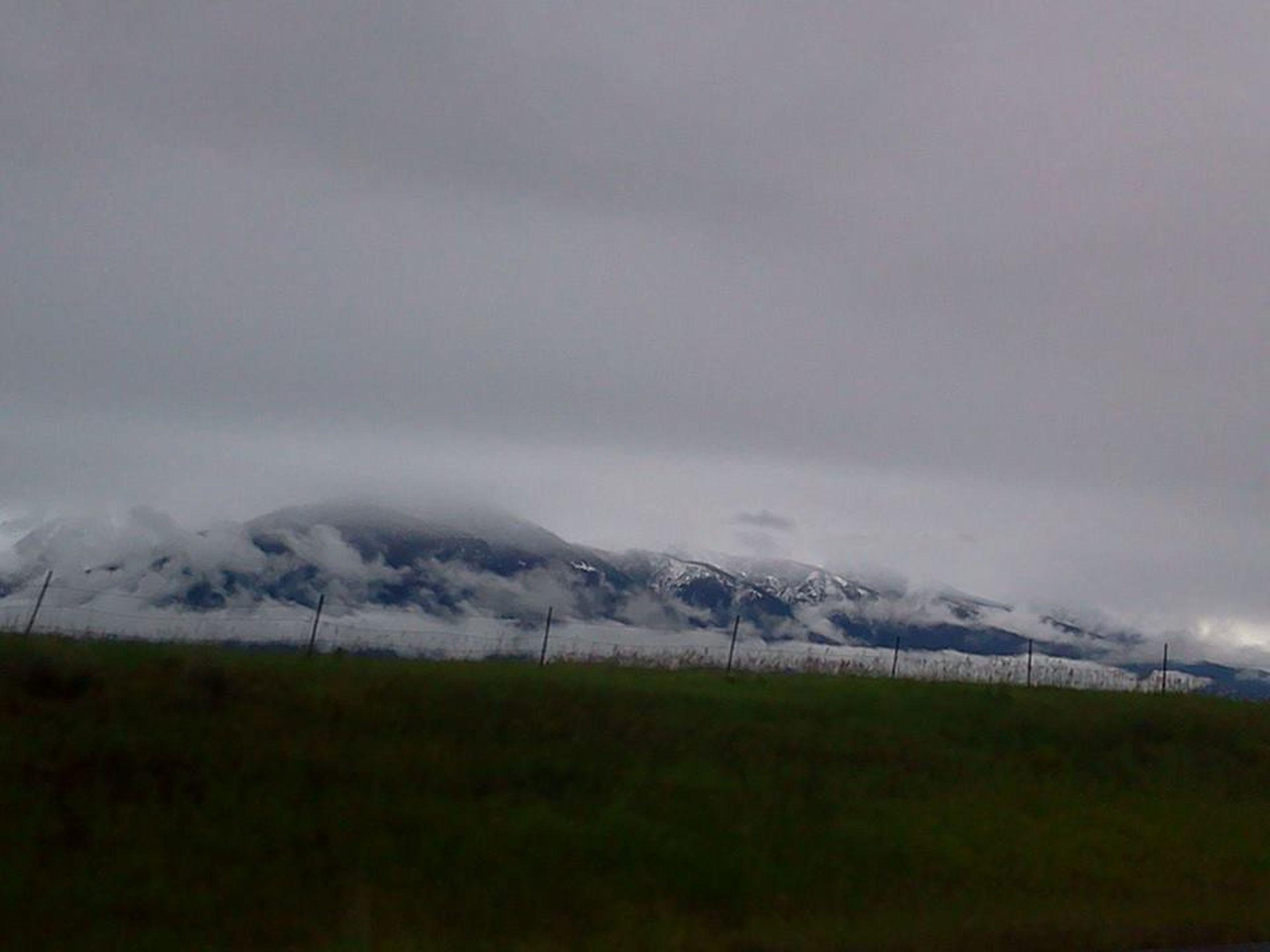landscape, mountain, tranquil scene, tranquility, scenics, weather, winter, sky, beauty in nature, cold temperature, snow, nature, field, grass, mountain range, cloud - sky, non-urban scene, cloudy, season, idyllic