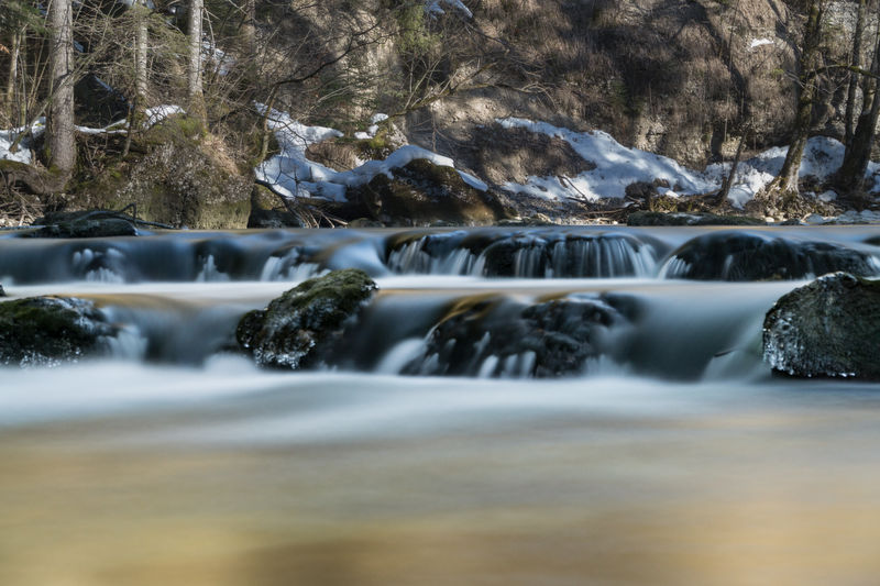 Cold Days Steiermark Austria Grundlsee Bad Aussee Winter Water Beauty In Nature Flowing Water Motion No People Nature Long Exposure Scenics - Nature Solid Rock Waterfront Tree Flowing Blurred Motion Rock - Object Waterfall Day River Forest Outdoors Stream - Flowing Water Running Water