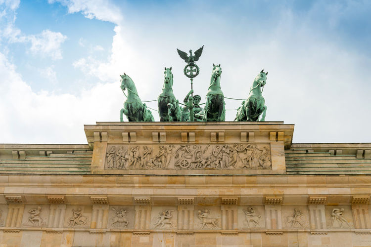 Architecture Brandenburg Gate City City Gate Day History No People Outdoors Sculpture Sky Statue