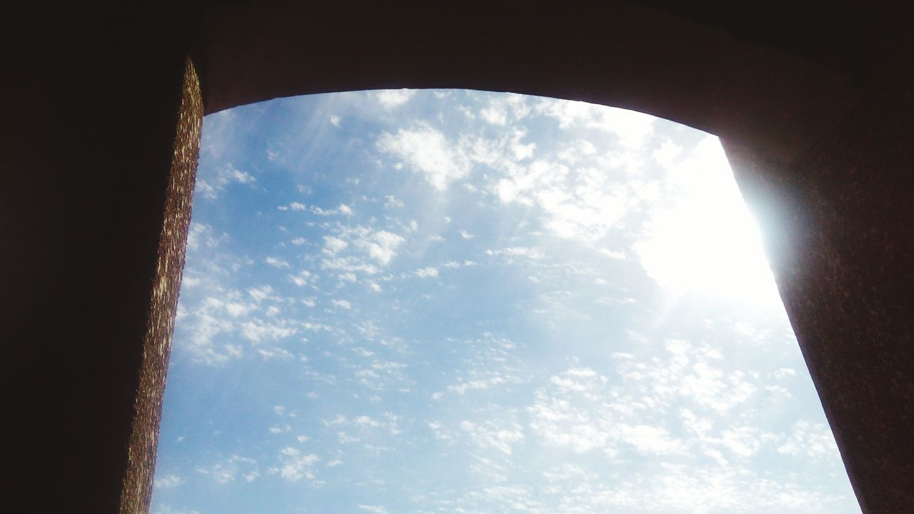 sky, cloud - sky, low angle view, day, no people, window, nature, sunlight, beauty in nature, indoors, scenics, tree
