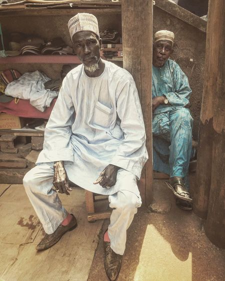 Market Merchants Front View Working Looking At Camera Occupation Portrait Full Length Only Men Two People Sitting Adult
