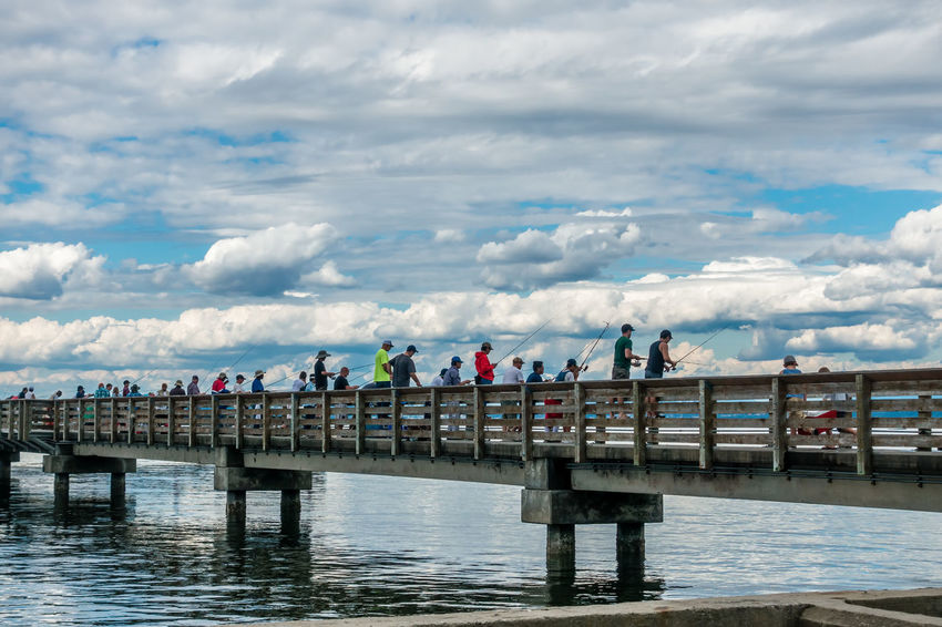 Fishing for salmon at Dash Point, Washington. Pier Cloud - Sky Clouds Dash Point Day Fishing Large Group Of People Leisure Activity Men Nature Outdoors People Real People Sea Sky Water Women