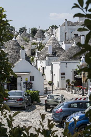The magic of Alberobello's Trulli travel location - It was really amazing to know this particulars constructions full of charming and to ear the history about the Alberobello's Trulli in the Italy Apulia region (Puglia). The history said that the Alberobello's origins date back to the Middle Age. The settlers built the houses with stone and without cement and with the easiest way to demolish them in the case of an inspection by the Kingdom of Naples, thus avoiding paying taxes. Another interesting thing is the decorative pinnacles and symbols painted on many roofs of the trulli that were often used to identify the different religions of their inhabitants. Albelobelo Italia Viajes  2019 EyeEm Awards The Traveler - 2019 EyeEm Awards The Architect - 2019 EyeEm Awards The Photojournalist - 2019 EyeEm Awards The Street Photographer - 2019 EyeEm Awards Italy EyeEm Gallery EyeEm Best Shots Eyeem4photography Building Exterior Architecture Built Structure Car Mode Of Transportation Motor Vehicle Transportation Building Residential District City House Land Vehicle Nature Street Day Plant Road Sunlight No People Sky Outdoors Luxury