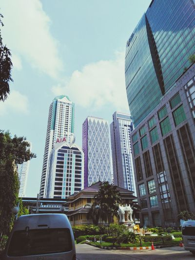 office building in bangkok Buildings Building Architecture Sky Cloud Cloud - Sky Business Tree Citylife Metropolis Bangkok Thailand Low Angle View High Town Tower City Modern Cityscape Tree Sky Architecture Building Exterior Built Structure Tower Office Building Tall Tall - High