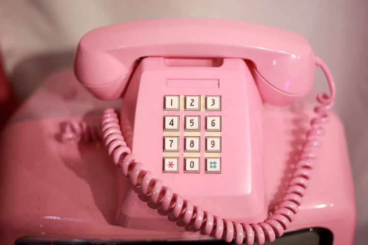 Close-up of pink telephone