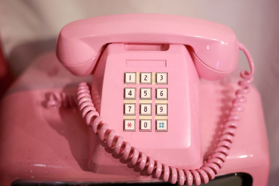 pink telephone Business Cable Close-up Communication Connection Finance Focus On Foreground Indoors  Landline Phone No People Number Phone Cord Pink Color Retro Styled Single Object Technology Telephone Telephone Receiver Wall - Building Feature