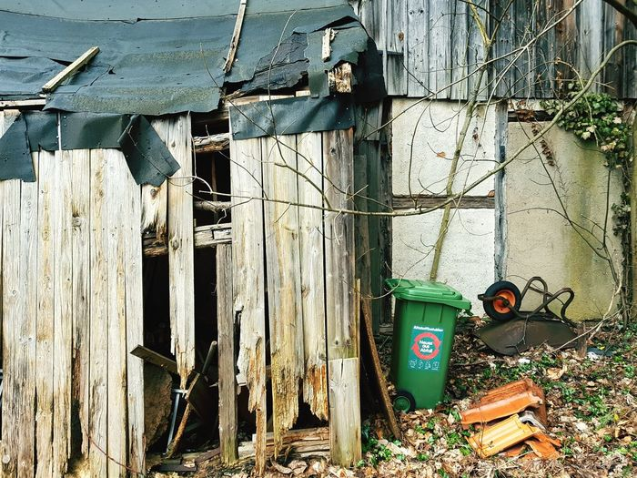 Old damaged shed Urban Old Rusty Damaged Weathered Wood Broken Trash Wheelbarrow Wood - Material Close-up Architecture Civilization Obsolete Ruined Worn Out