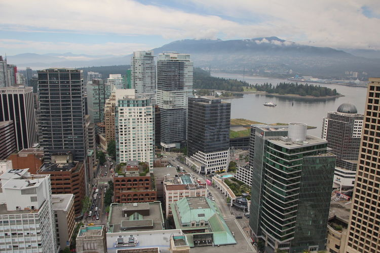 Vancouver from above Building Exterior Architecture Built Structure Building City Cityscape Sky Cloud - Sky Skyscraper Residential District Office Building Exterior No People Nature Modern High Angle View Outdoors Tall - High Water Day High Apartment Financial District