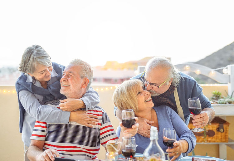 Happy senior couples at building terrace