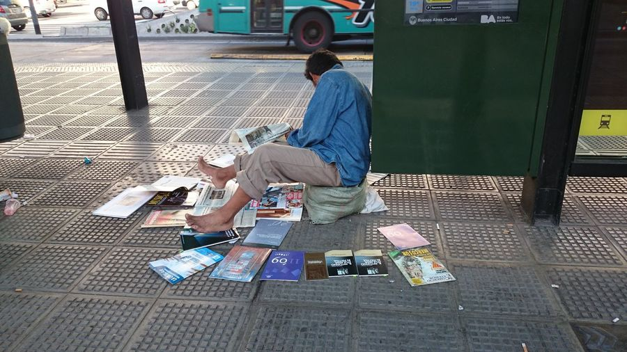Book Seller Selling Books Near Bus Stop