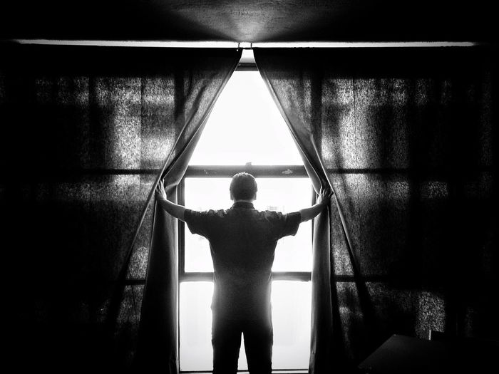 Rear view of boy standing in corridor