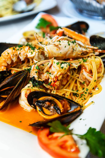 Close-up of pasta with seafood in plate on table