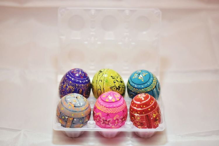 High Angle View Of Colorful Easter Eggs In Crate On Table