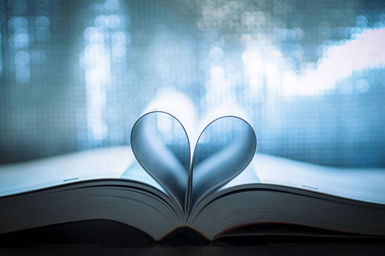 Book of love Heart shaped at the book with a blurry background. Bokeh Bokeh Lights Bokeh Photography Bokehlicious Book Books Close-up Day Education Heart Shape Indoors  Lifestyles Light Light And Shadow Light And Shadows Light In The Darkness Light Up Your Life Lighthouse Lighting Equipment Lights Love No People Page Still Life Table
