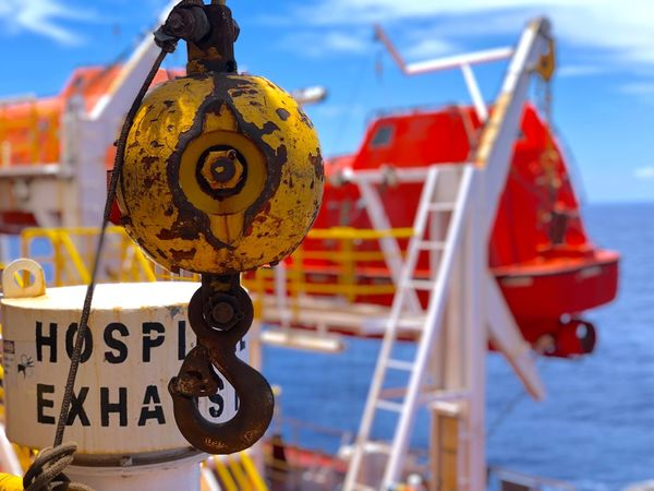 Hook crane on FPSO lifeboats area Rusty White Ocean Exhaust Fan Life Boat Station Lifeboats Crane Life Boat Lifeboat Hook Platform FPSO Oil And Gas Offshore Text Focus On Foreground No People Day Metal Close-up Transportation Outdoors Sign Hanging Mode Of Transportation Yellow Red Sky