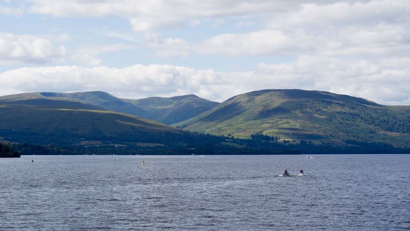 Jet Ski on Loch Lomond Captain Haddock Jet Ski Scotland Beauty In Nature Cloud - Sky Day Loch Lomond Mountain Mountain Range Nature Outdoors Scenics Sky Tintin Tranquility Water Waterfront