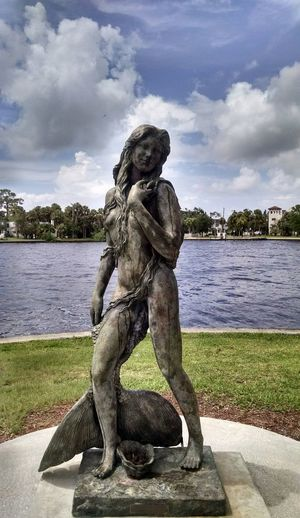 Ama The Mermaid Statue Of Tarpon Springs Craig Park, Tarpon Springs, FL Mermaid Mermaids Lake Beauty In Nature Travel Photography Travel Travel Destinations Art Water Sculpture Statue Arts Culture And Entertainment Human Representation Sky Female Likeness Sculpted The Great Outdoors - 2018 EyeEm Awards The Still Life Photographer - 2018 EyeEm Awards The Photojournalist - 2018 EyeEm Awards The Traveler - 2018 EyeEm Awards The Portraitist - 2018 EyeEm Awards The Creative - 2018 EyeEm Awards The Street Photographer - 2018 EyeEm Awards #urbanana: The Urban Playground Summer In The City