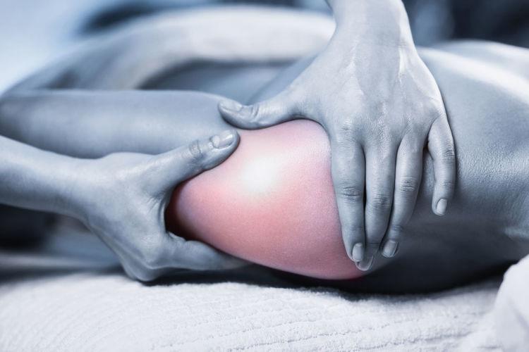 Cropped Hands Massaging Woman Shoulder At Spa