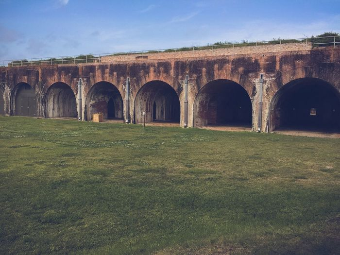 Fort morgan Travel Vacation Fort Morgan Old Arch Architecture Grass Sky Day Built Structure No People Outdoors Landscape Nature