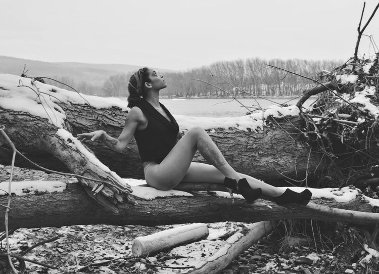 Waiting Black And White Single Person Lingerie Nylons Heels Vest Fashion Womensfashion Stockings Dead Tree River Winter Cold Snow Icy Portrait Of A Woman Solitary Waiting Young Women Beautiful Woman Beauty Women Portrait Full Length Beautiful People Sitting Water Females