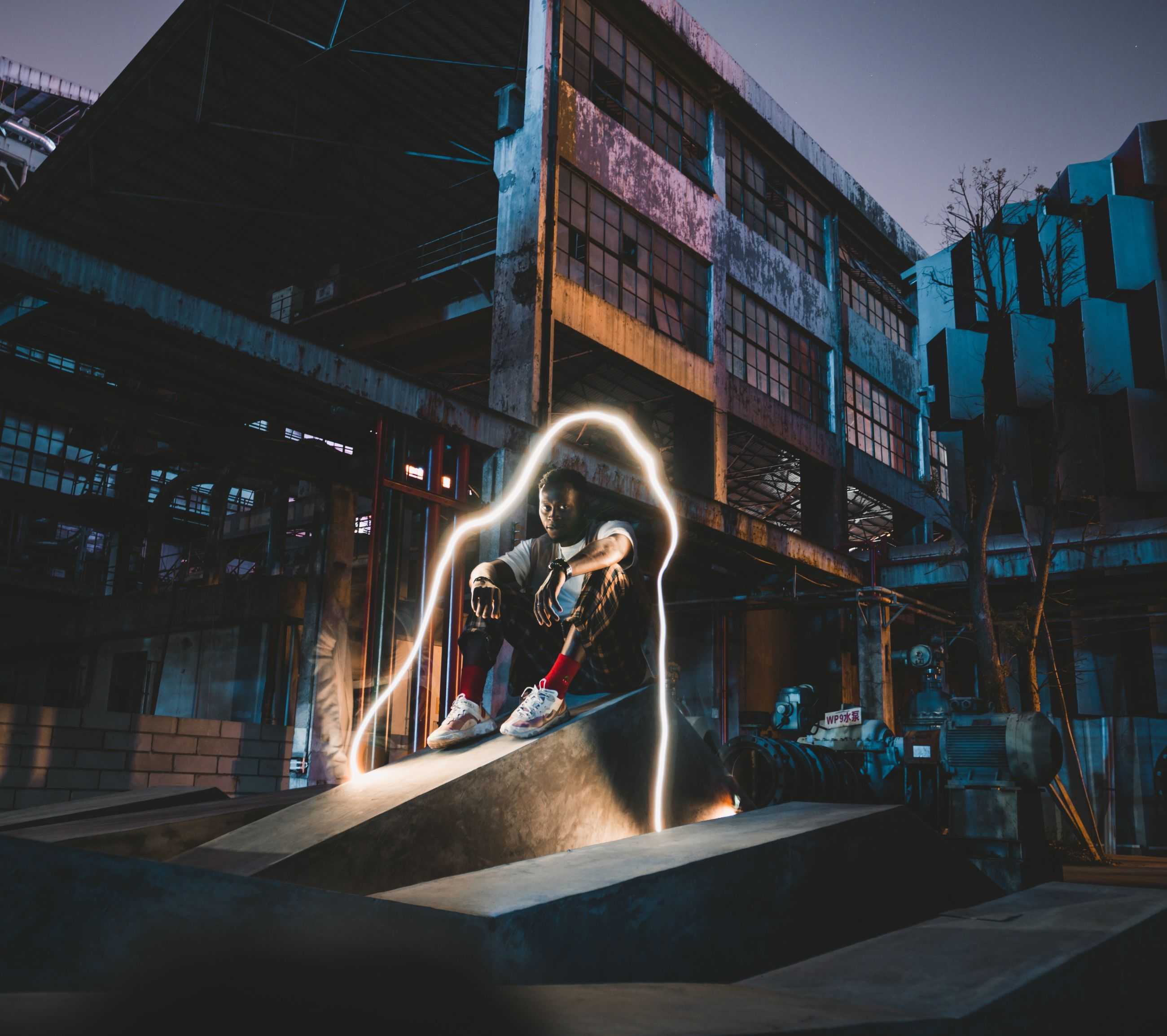 real people, built structure, architecture, motion, one person, building exterior, lifestyles, nature, skill, illuminated, women, blurred motion, men, leisure activity, sport, sky, outdoors, industry, occupation