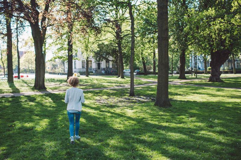 Full length of woman walking at park