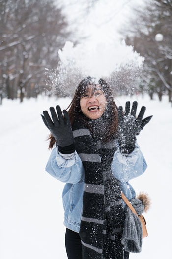 Let it go ASIA Asian  Happy Japan Japan Photography Japanese  Travel Cheerful Clothing Cold Temperature Day Emotion Enjoyment Front View Fun Happiness Human Arm Leisure Activity Motion Nature One Person Outdoors Portrait Sapporo Smiling Snow Snowing Tree Warm Clothing White Color Winter Women