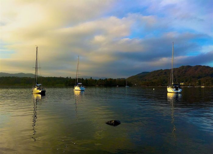 Nautical Vessel Sky Mode Of Transport Water Transportation Cloud - Sky Beauty In Nature Reflection Waterfront Nature Scenics No People Outdoors River Tranquility Sailboat Day Mast Mountain