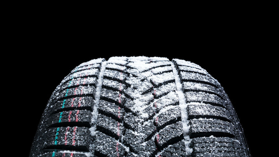 Close-up of tire against black background