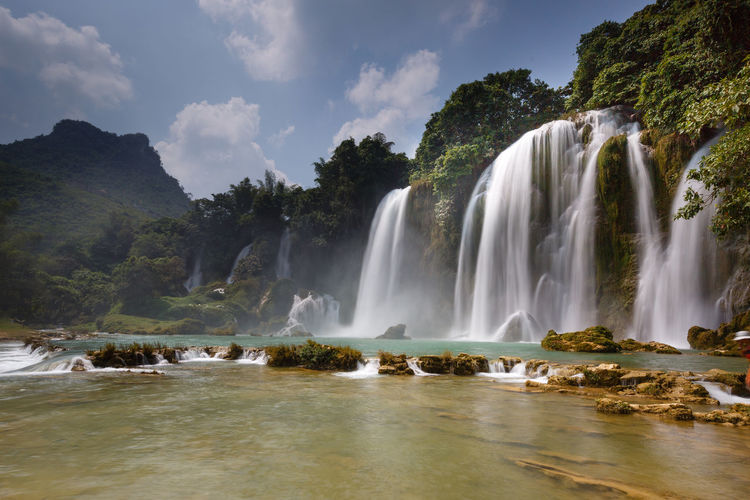 Ban Gioc waterfall in Cao Bang, Viet Nam - The waterfalls are located in a border area between Vietnam and China. These are one of the nicest waterfalls in northern Vietnam. Bangioc Caobang Environment Environmental Conservation Famous Place Forest Freshness Nature No People Paradise Scenics Smooth Steam Stone Stream Summer Tourism Tourisme Travel Travel Tree Vacations Water Waterfall Wet